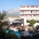 Вид из окна отеля Kemer Dream Hotel 4* на горы и бассейн.