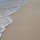 Белоснежный песок пляжей Канкуна на Карибском море.