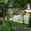 «Сад цветов» фонтан раковина и медведь в Липецком зоопарке.